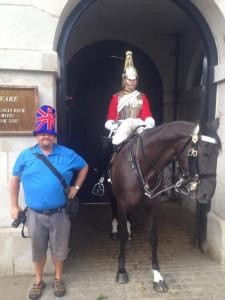 Chris poses with guard near Downing St, London, UK. Aug 2014. Photo Rich Mooney.