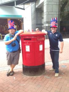 Chris & Rich pose by Royal Mail box in London. Aug 2014.